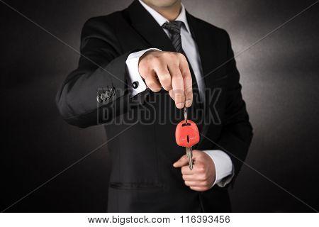 Businessman giving a car key