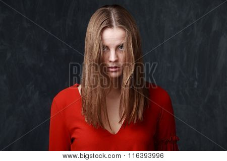 Young Melancholic Woman In Red Dress, Face Is Partly Closed By The Hair