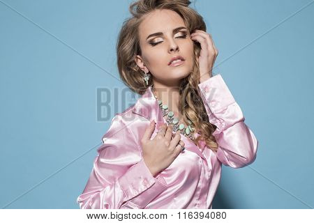 Woman With Long Curly Blond Hair Elegant Clothes And Bijou