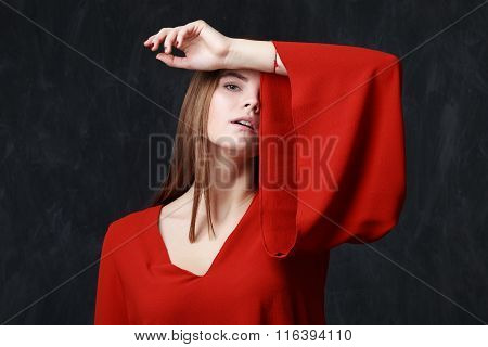 Portrait Of A Beautiful Sad Woman In Red Dress
