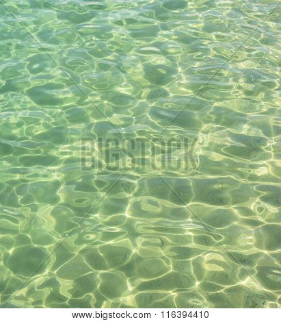 Flecks Of Sunlight Are In Clear Sea Water.