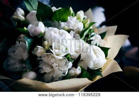 Bouquet of white peonies in wedding day