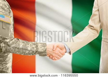 Usa Military Man In Uniform And Civil Man In Suit Shaking Hands With National Flag On Background - I