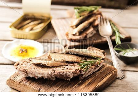 Sandwich Tapas With Sardines, Sprats Olives And Salt