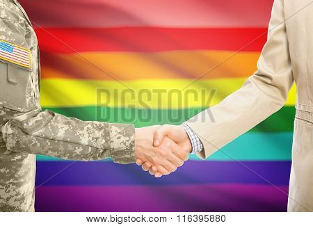 Usa Military Man In Uniform And Civil Man In Suit Shaking Hands With National Flag On Background - L