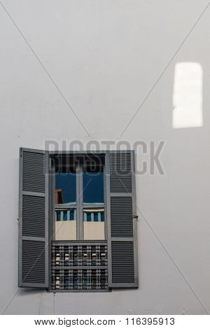 White Wall With A Window With Reflection