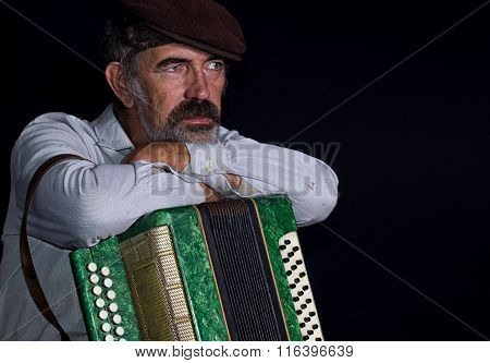 Portrait of elderly country man with button accordion