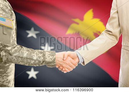 Usa Military Man In Uniform And Civil Man In Suit Shaking Hands With National Flag On Background - P