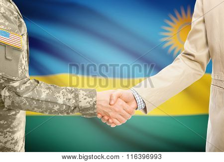 Usa Military Man In Uniform And Civil Man In Suit Shaking Hands With National Flag On Background - R