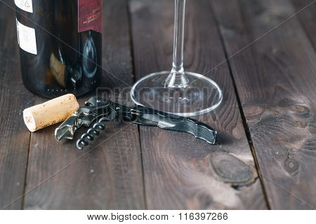 Corkscrew Wine Bottle And Glass On The Wooden Table