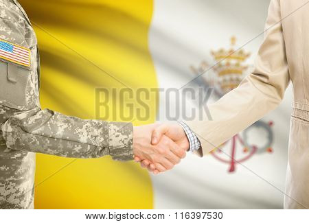 Usa Military Man In Uniform And Civil Man In Suit Shaking Hands With National Flag On Background - V