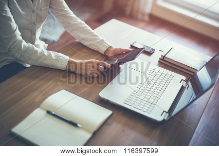 business woman hand working laptop computer on wooden desk.