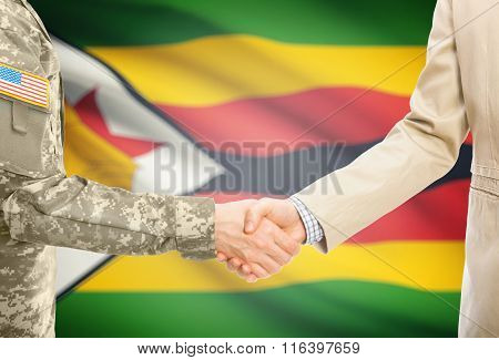Usa Military Man In Uniform And Civil Man In Suit Shaking Hands With National Flag On Background - Z