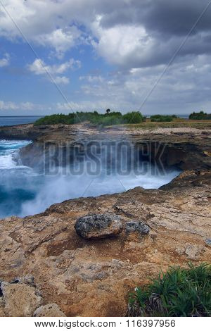 Surf In The Rocks Near The Island Of Lembongan Bali, Indonesia