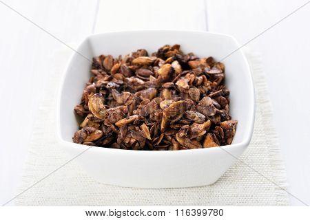 Chocolate Granola In White Bowl