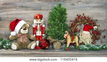 Christmas Decoration. Antique Toys Teddy Bear And Nutcracker
