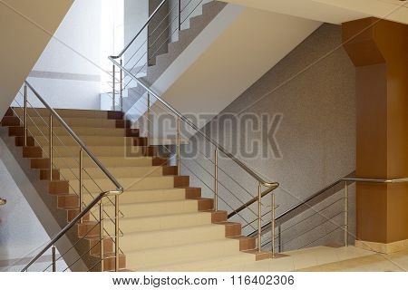 Brown Staircase With Metal Railing, Gray Wall