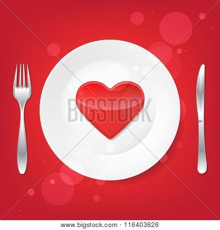 Lovely food. Fork and knife and heart on the plate.
