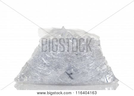 Full Plastic Bag Of Crushed Ice Isolated On White Background With Reflection