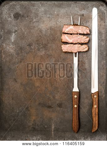 Grilled Beef Meat With Fork And Knife. Food Background