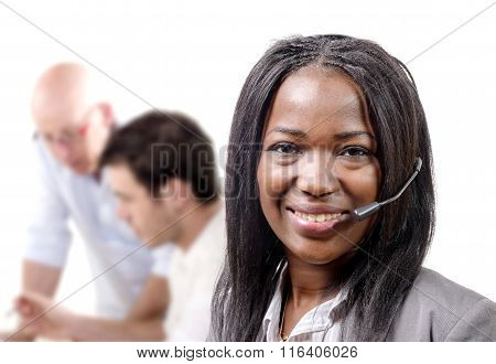 Portrait Of Smiling Cheerful African Support Phone Operator In Headset.