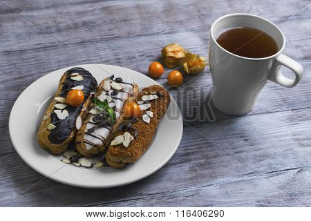 Plate With Cakes Eclairs Decorated