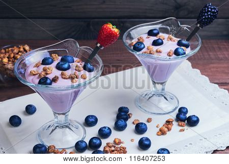 Two Glass Vases Decorated With Berries And Granola Yogurt