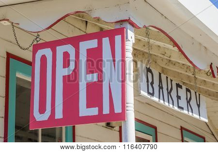 Open Sign At A Bakery In Coulterville, California