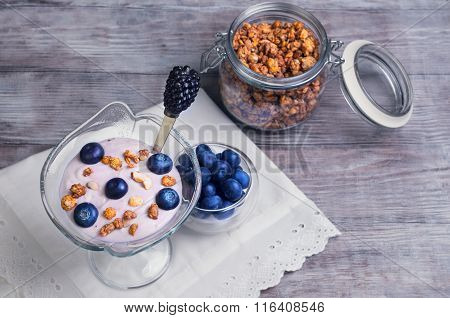 Glass Vase Decorated With Berries And Granola Yogurt