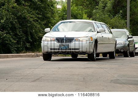 White Lincoln Town Car Limousine At The City Street