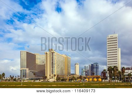 TEL AVIV, ISRAEL - JANUARY 1, 2016: Skyscrapers on the embankment of Tel Aviv. Windy and bright winter day on the sea coast