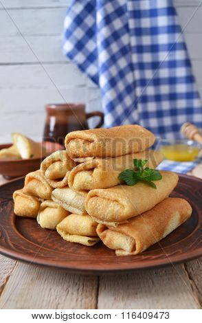 Pancakes with curd on a large plate