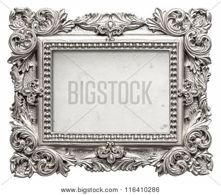 Silver picture frame with grungy canvas. Vintage baroque art object isolated on white background