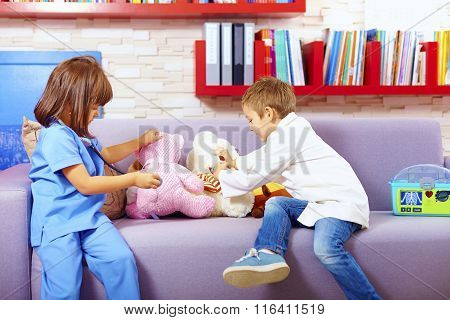 Cute Kids Playing Doctors With Toys In Office