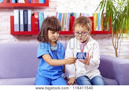 Cute Kids Playing Doctors In Office