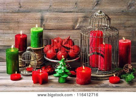 Christmas Decoration With Burning Candles And Red Baubles