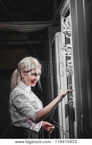 Young engineer businesswoman in server room