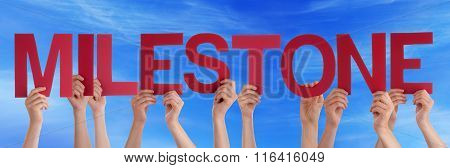 Many People Hands Holding Red Straight Word Milestone Blue Sky