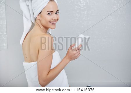 Beautiful  Woman applying facial moisturizing cream.Skincare concept