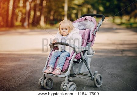 young family walking in the park