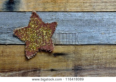 Sparkle and glitter star on pallet wood