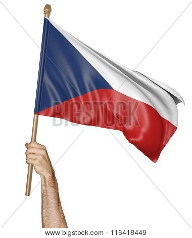Hand proudly waving the national flag of the Czech Republic
