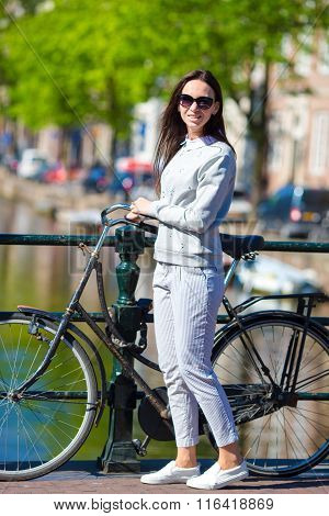 Happy woman with bicycle on european vacation