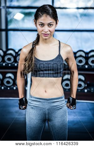 Fit woman with clenched fist at gym
