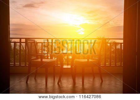 Served table with romantic view to sea on terrace