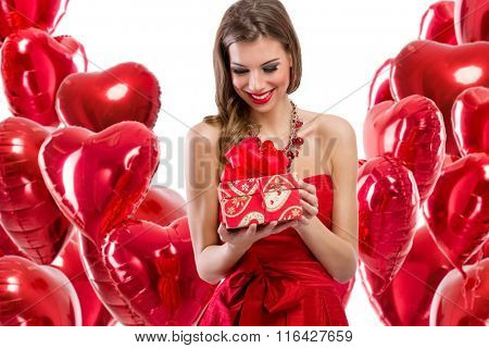 Happy woman looking at her gift for Valentine's day