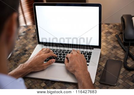 Man hand working on the laptop, back view