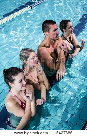 Fitness group doing aqua aerobics in swimming pool