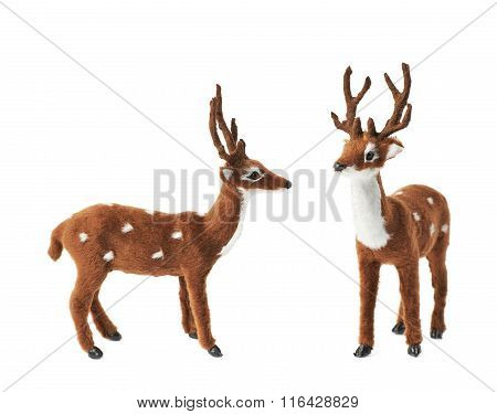 Toy roe deer fawn figurine isolated over the white background, set collection of two different foreshortenings