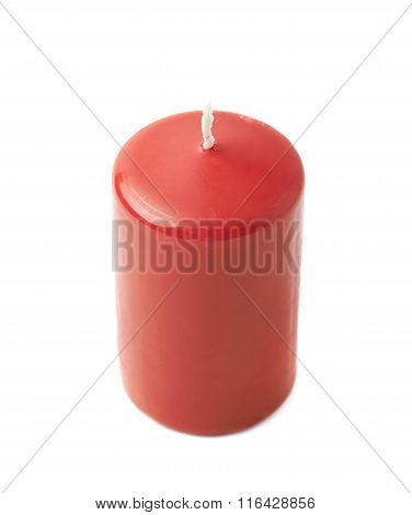 Unused red wax candle isolated